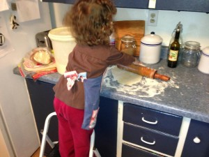 Teaching my granddaughter to roll out a pie crust. She really got the hang of it.