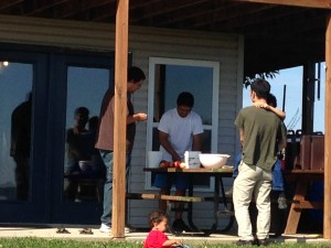Some of the guys...cutting apples and discussing Kenji's Tesla generator.