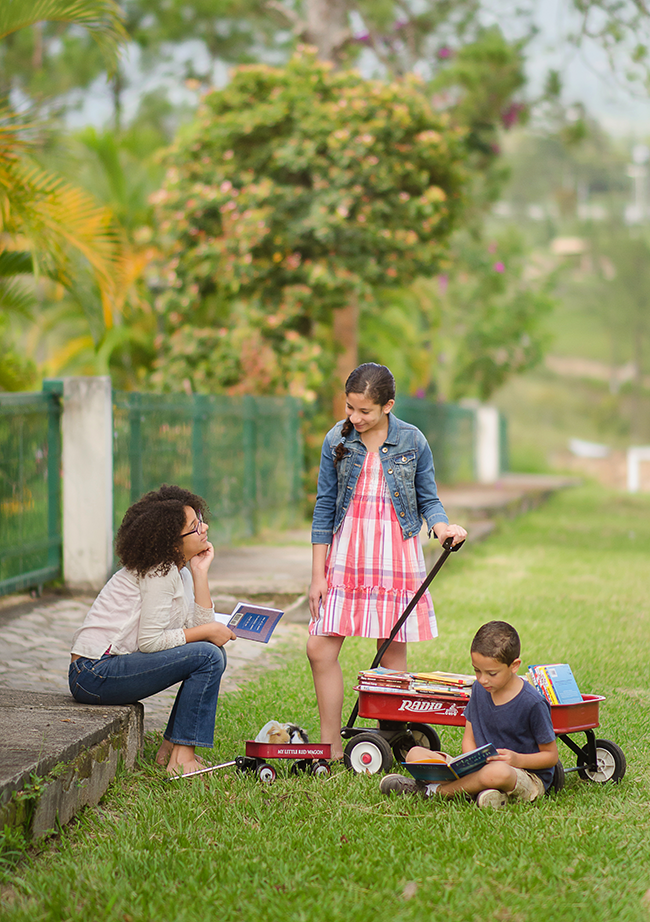 Two sisters with wagons and their brother, photo by the M Family of Siguatepeque, Honduras • 2nd Place Sonlight 2018 catalog cover contest