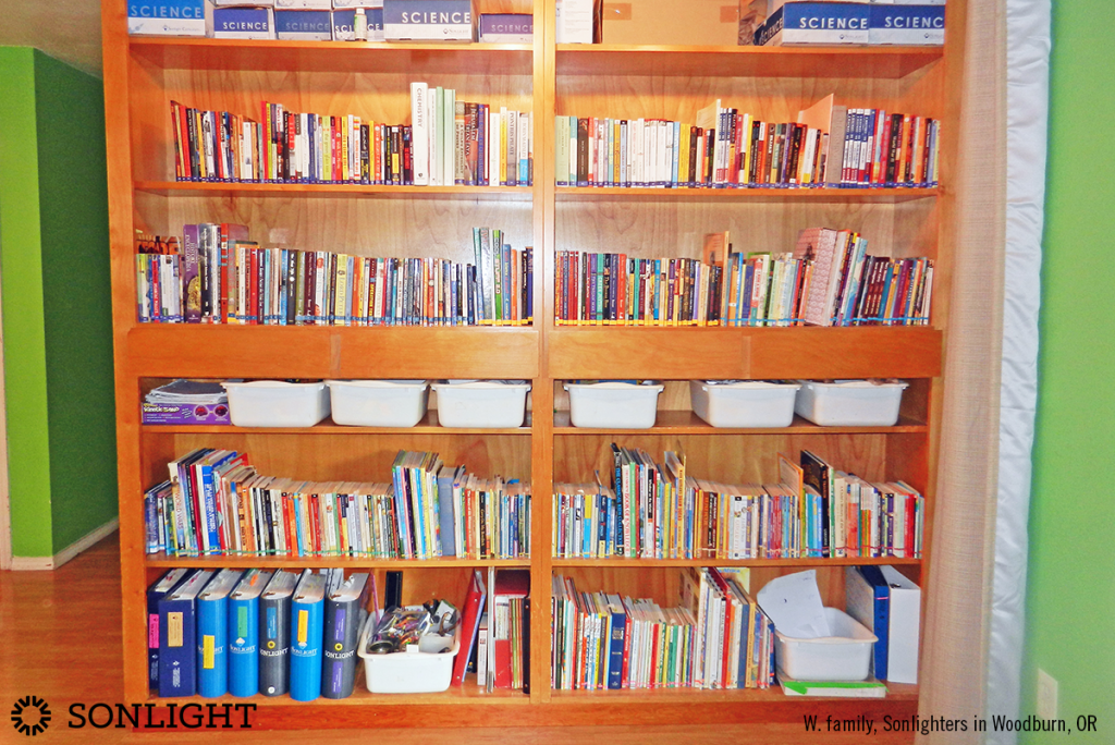 massive bookshelf for years of Sonlight homeschool curriculum