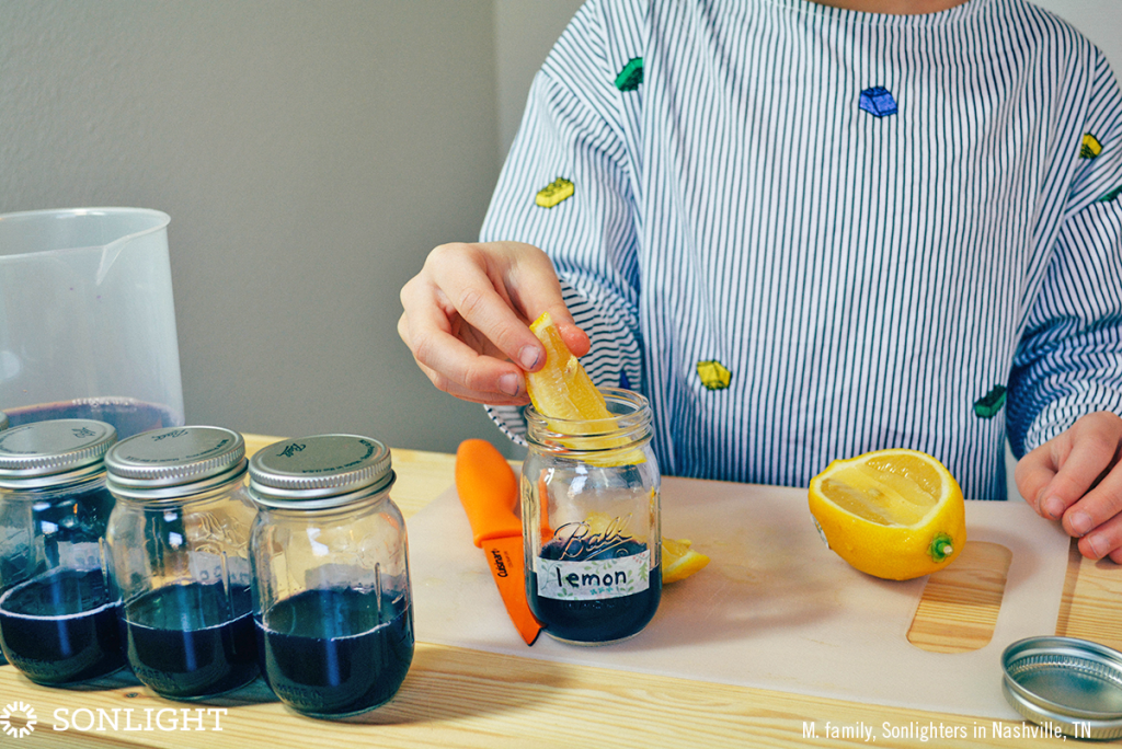 Squeeze lemon juice into the jar labeled lemon, then drop the wedge in the liquid, too.