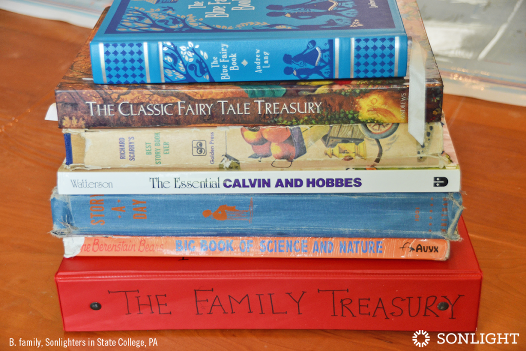 How to Create a Family Anthology of Your Child's Creations • The Family Treasury shown in a stack with other favorite volumes.
