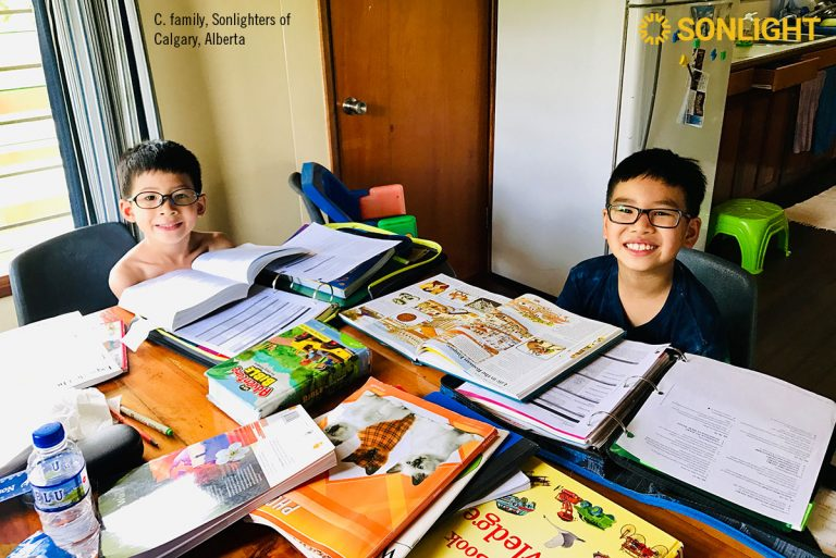 Missionary kids Evan (8) and Wesley (6) enjoy doing school together in Papua New Guinea. the C. family, Sonlighters of Calgary, Alberta