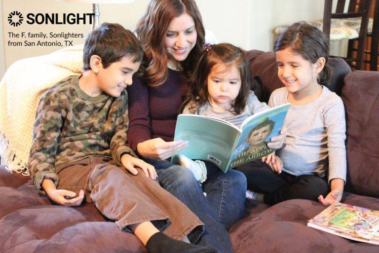 mom reads to three children