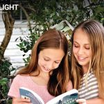 Two sisters share a book